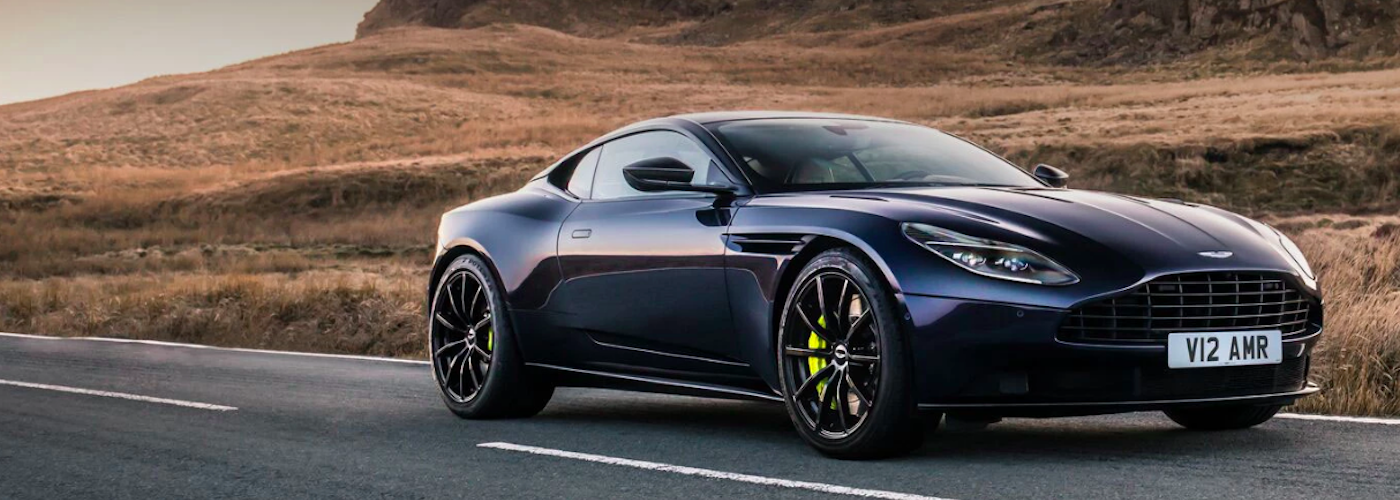 Aston Martin parked on side of highway