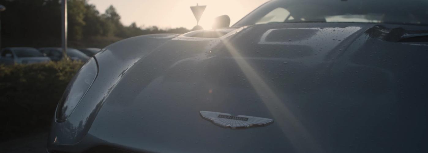 Aston Martin logo on model parked in ray of light