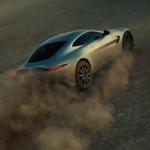 Aston Martin Vantage driving fast in the desert