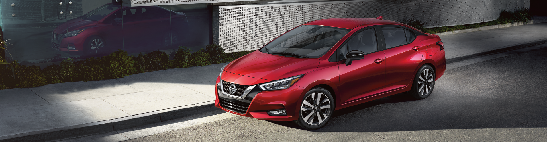 2020 Nissan Versa Red Sedan on City Street