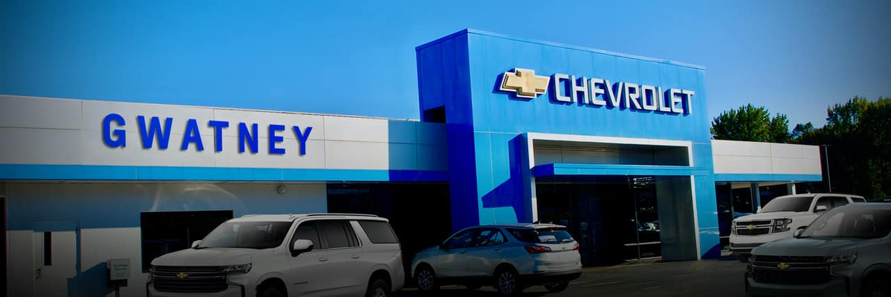 An exterior shot of a Chevrolet dealership at night.