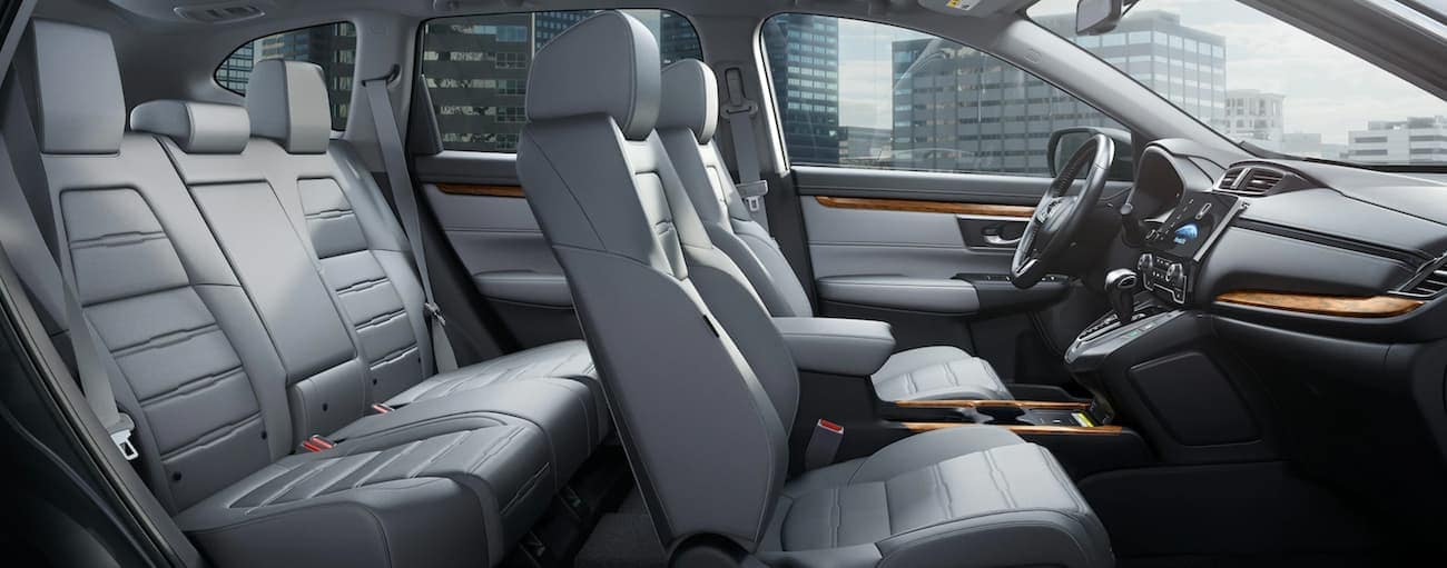 The grey interior of a 2020 Honda CR-V Touring is shown from the side.