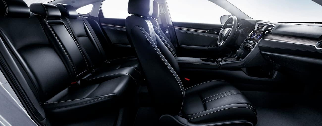 A side view of the black leather interior of a 2020 Honda Civic Sedan Touring is shown.