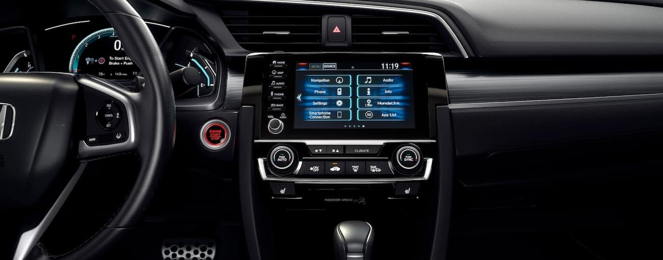 The infotainment screen in a 2020 Honda Civic Sedan Touring is shown.