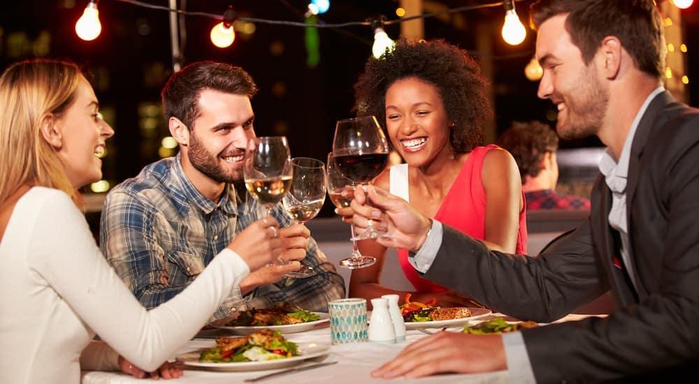 Friends are eating outdoors at night at a restaurant in Atlanta, GA.