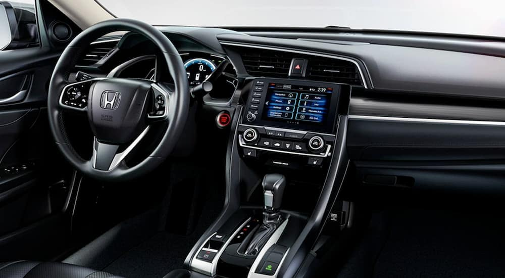 The black interior of a 2020 Honda Civic is shown.