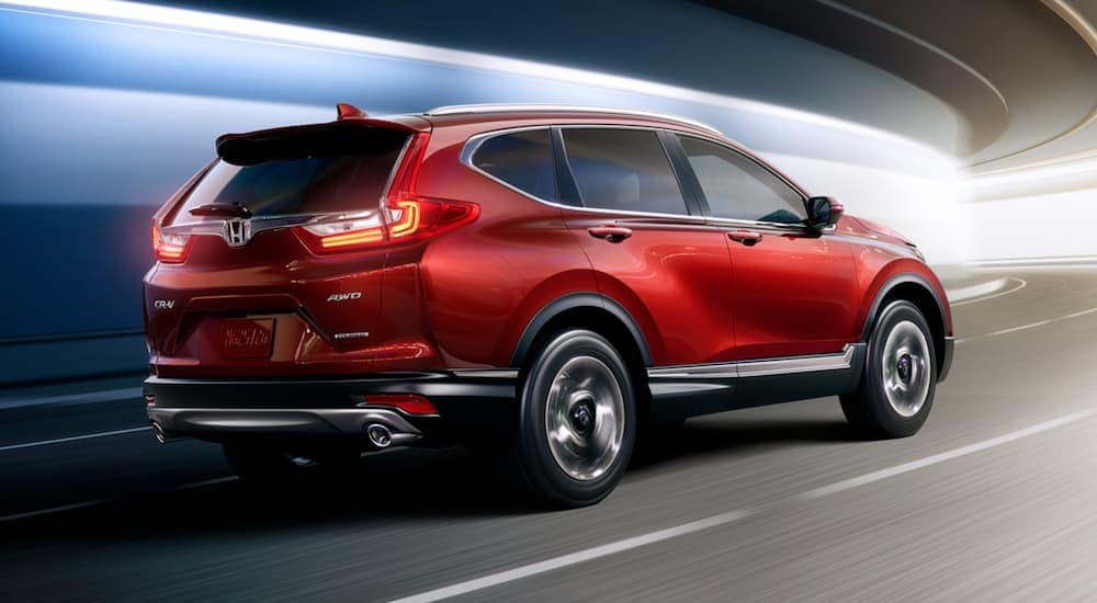 A red 2017 Honda CR-V is driving through a tunnel.
