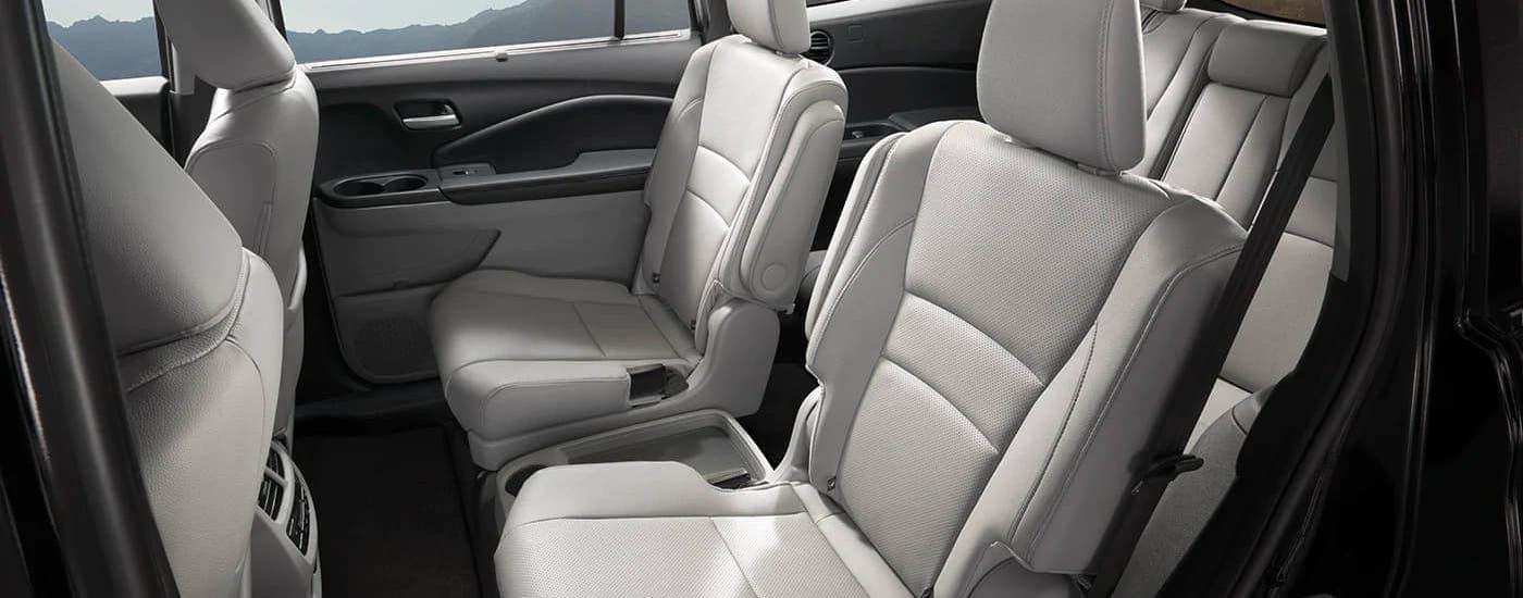 The gray interior seats of a 2020 Honda Pilot Elite are shown.