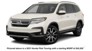A white 2021 Honda Pilot Touring is angled left.