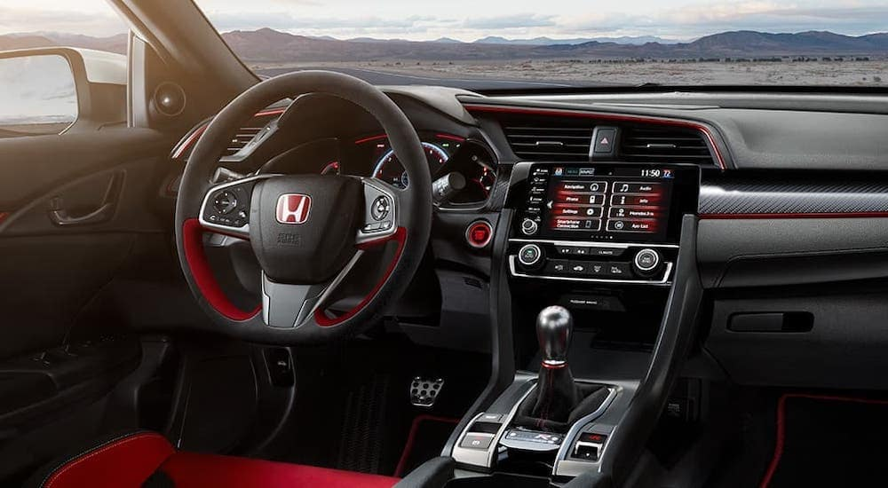 The black interior with red accents of a 2021 Honda Civic Type R is shown.