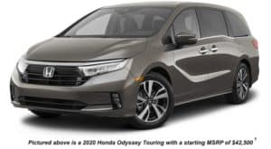 A brown 2021 Honda Odyssey Touring is angled left.