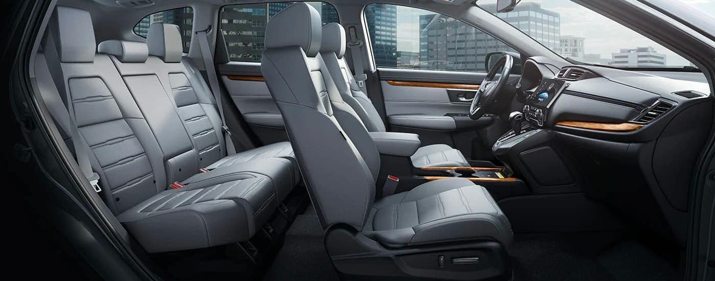 The gray interior of a 2020 Honda CR-V Touring is shown from the passenger side.