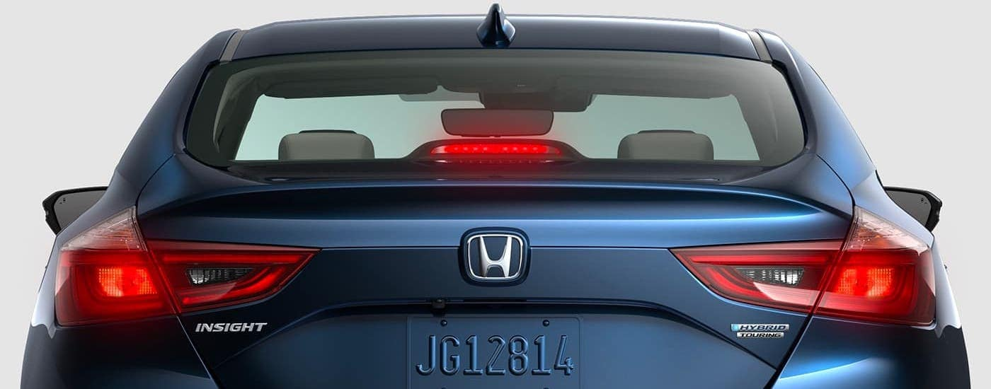 A blue 2021 Honda Insight Touring is shown from the rear.