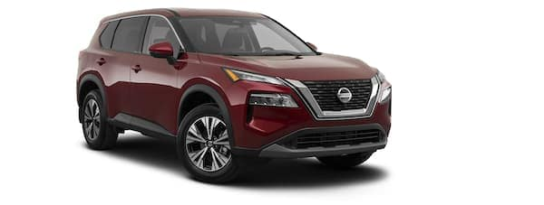 A red 2021 Nissan Rogue is shown from the left.