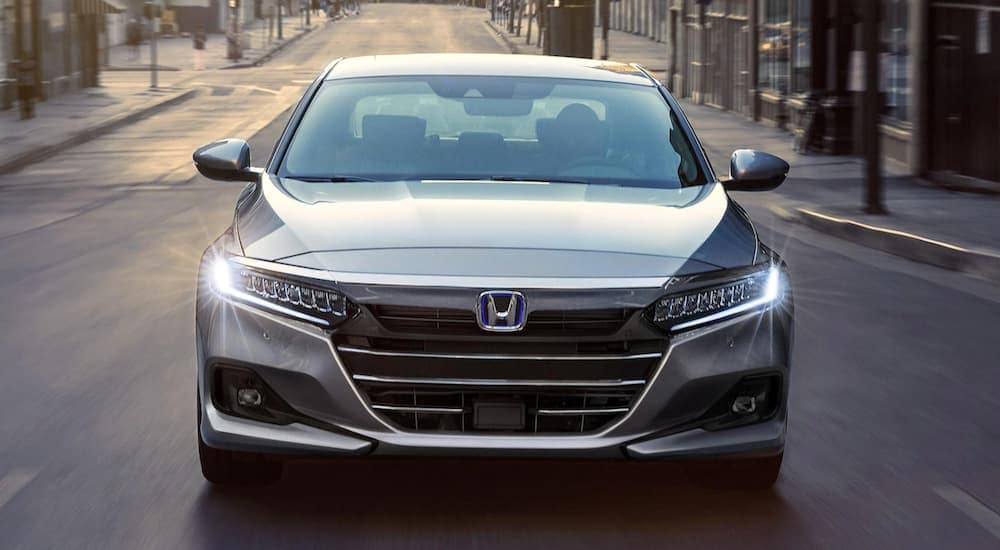 A grey 2021 Honda Accord Hybrid is shown from the front on a city street after leaving an Atlanta Honda Accord dealer.