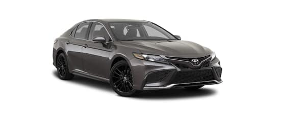 A dark grey 2021 Toyota Camry is angled right.