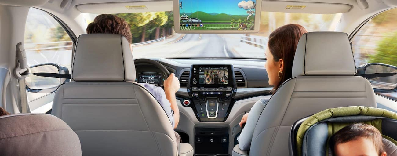 The infotainment screens are shown from the middle seats in a 2022 Honda Odyssey Elite.