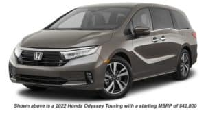 A grey 2022 Honda Odyssey Touring is angled left.