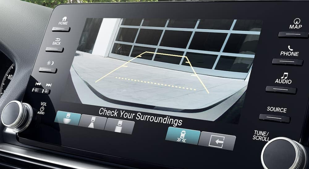A close up shows the back up camera view on the infotainment screen of a 2021 Honda Accord.