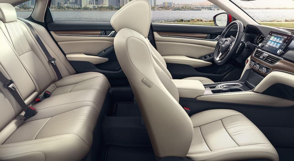 The beige seats are shown from the passenger side of a 2021 Honda Accord.