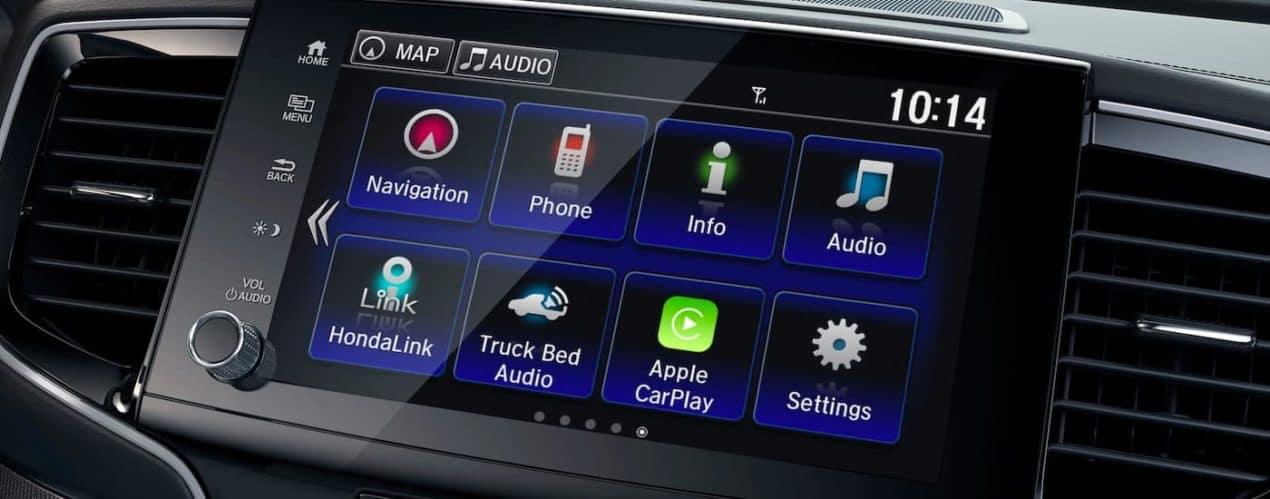 A close up shows the infotainment screen menus in a 2021 Honda Ridgeline RTL-E.