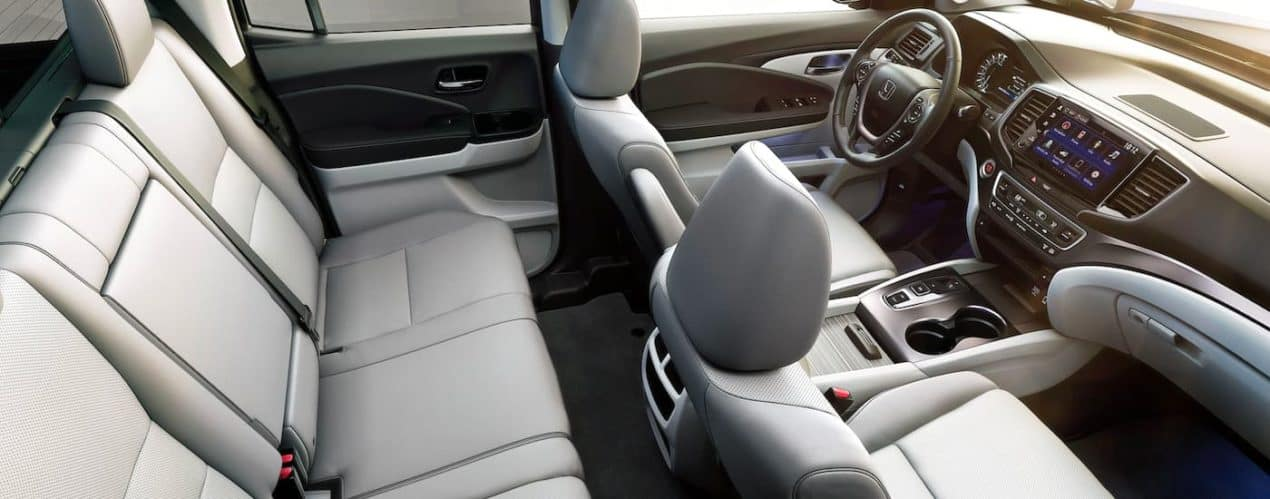 The grey leather interior is shown from a high angle in a 2021 Honda Ridgeline RTL-E.