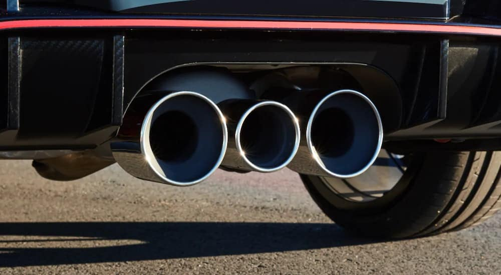 The muffler of a 2021 Honda Civix Type R is shown from a low angle.