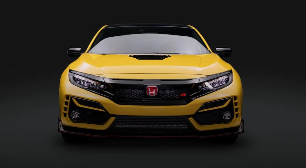 A yellow Honda Civic Type R is shown from the front after leaving a Atlanta Honda Civic dealer.
