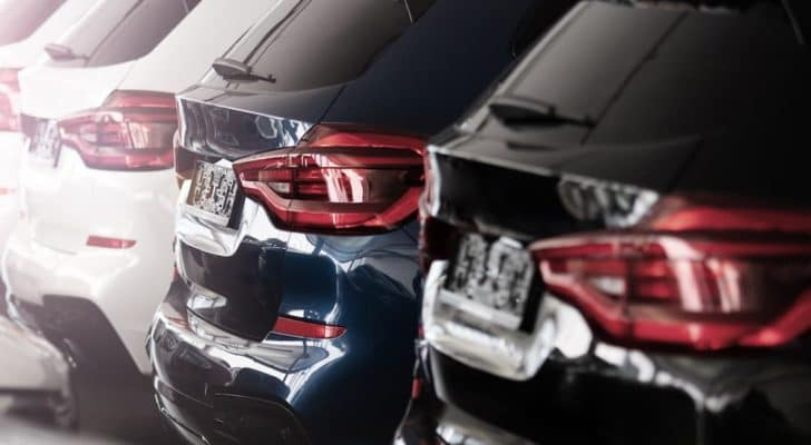 The liftgates of several SUVs at an Atlanta used luxury car dealership are shown.