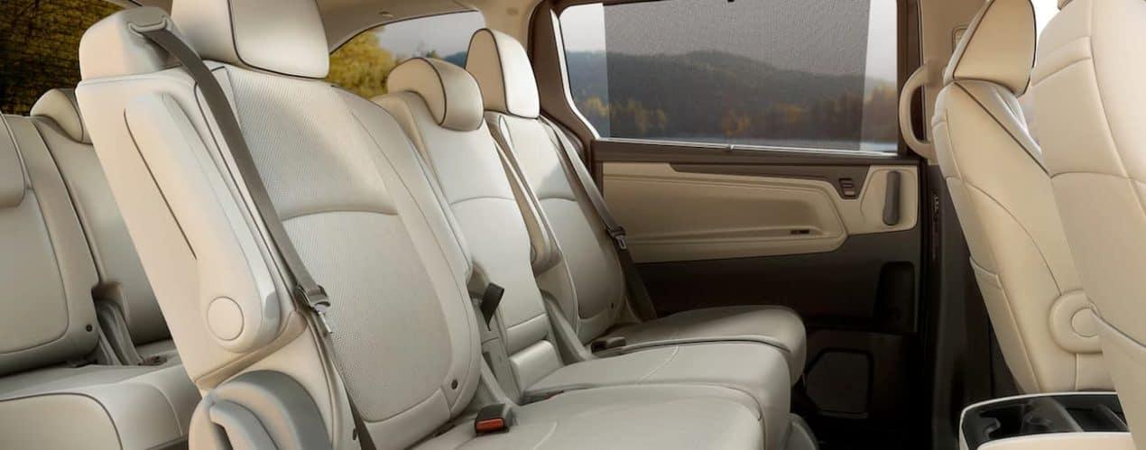 The rear seats in the cream interior of a 2022 Honda Odyssey are shown.