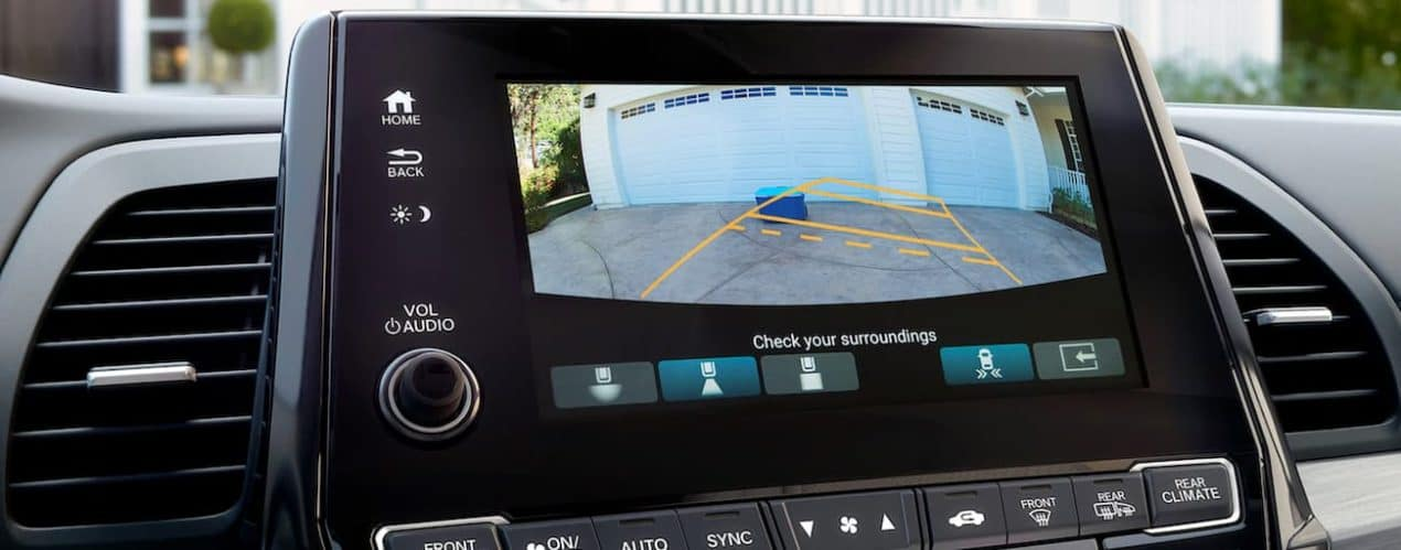 The rear camera view is shown on the screen in a 2022 Honda Odyssey.