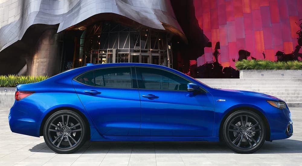 A blue 2020 Acura TLX is shown parked from the side.