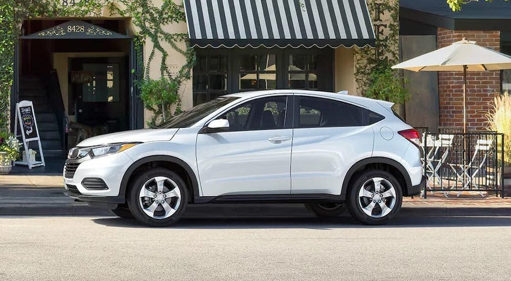 A white 2020 Honda HR-V LX is parked in front of a cafe near Newnan, GA.
