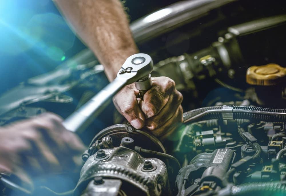 Mechanic Tightening a Bolt