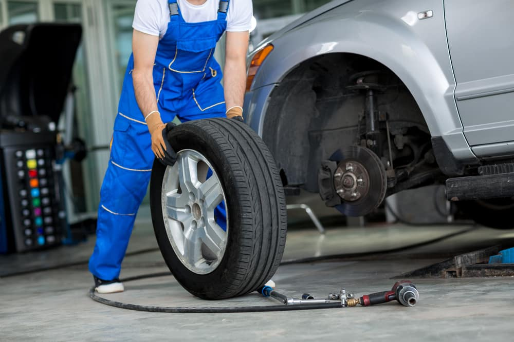 Routine Tire Rotation on Vehicle