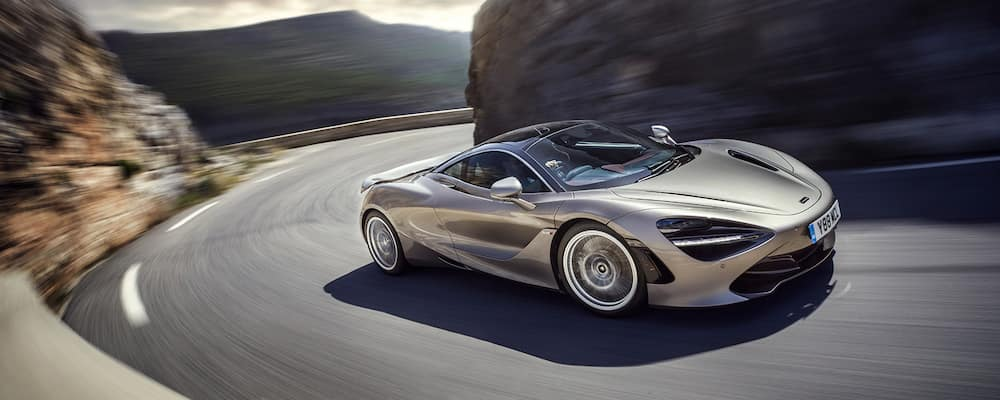 Beige 720S driving on mountain highway