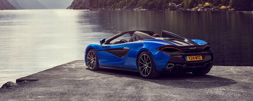 Blue 570S Spider parked near water