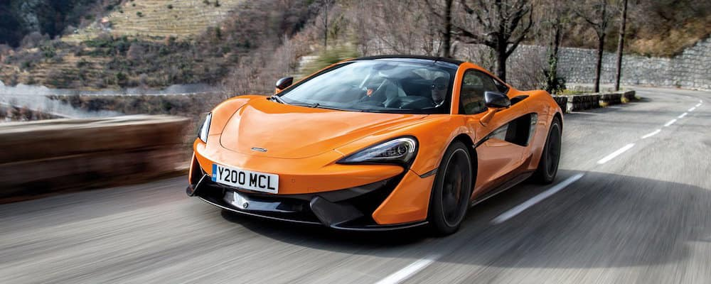 Orange 570S Coupe on highway