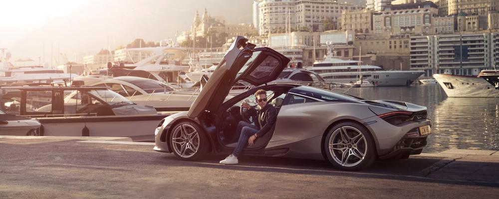 2021 McLaren 720S with doors open and man sitting inside