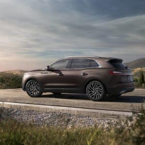 2020 Lincoln Nautilus Ochre Brown exterior parked at a scenic overlook