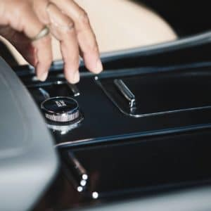 Hand reaching for the Lincoln Drive Modes knob