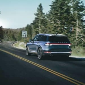 Lincoln Aviator is shown being driven on a mountain road