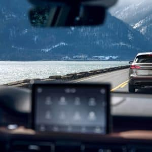 Vehicle braking visible through the windshield of a Lincoln Aviator