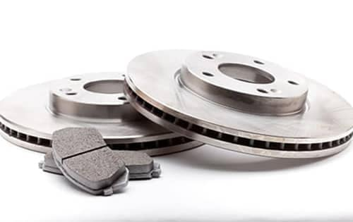 Brake pads next to rotors